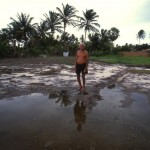 Alouiso Rodrigues dos Santos stands in what was once his vegetable garden, now a saline wasteland.