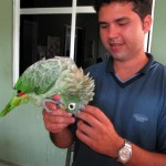 Rogerio and his parrot.
